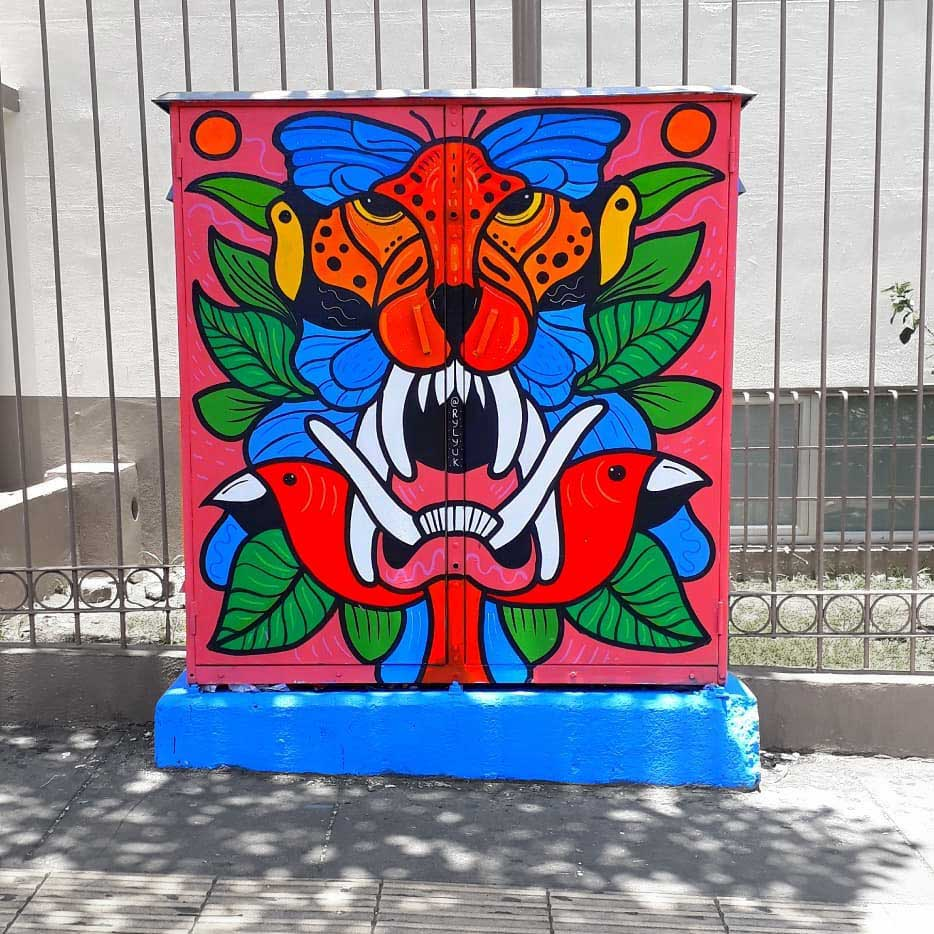 a junction telephone box painted with a jaguar, birds and morpho butterfly by Ryliuk